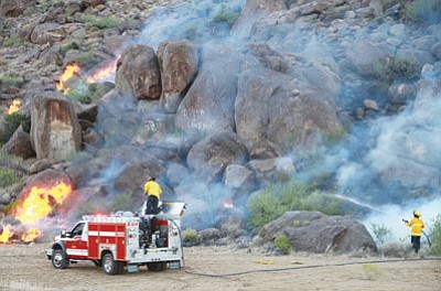 Firefighters respond to a wildfire along Stockton Hill Road north of Kingman in June 2012. (JC AMBERLYN/Miner)