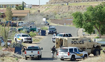 Law enforcement responded in force to a Kingman home April 22 regarding an allegedly barricaded man, Victor Franklin Garrett, who was indicted on assault and weapons charges last week. (RYAN ABELLA/Miner)