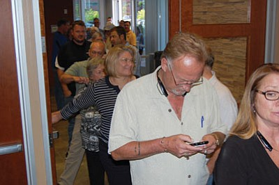 People line up out the door of the Mohave County Board of Supervisors auditorium at Tuesday's City Council public hearing regarding Kingman Crossing. The majority of nearly 50 people who spoke were in favor of the project. (DOUG McMURDO/Miner)
