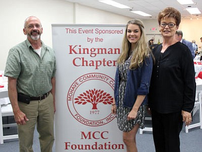 The Mohave Community College Foundation recently honored its Kingman donors and scholarship recipients. From left are Tom Spear, executive vice president of the Historic Route 66 Association; Ashley Ketchner, nursing graduate; and Kerry Raymond, MCCF Kingman chapter vice president. /Courtesy