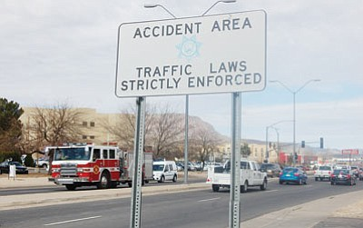 "The Arizona Department of Public Safety on Friday issued Kingman Fire Department Battalion Chief Bill Johnston a citation for failure to yield to a pedestrian in a crosswalk, 10 months after Johnston struck a woman who was walking across Stockton Hill Road. The woman died from her injuries and attorneys for the woman's daughter claim the city is liable for her death for failing to fix the ""known deficiencies"" in Kingman's heavily traveled commercial corridor. (DOUG McMURDO/Miner)"