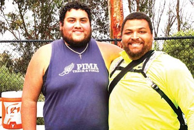 Former Kingman High Bulldog Christian Gutierrez, left, has his picture taken with Reese Hoffa, the bronze medalist in the shot put at the 2012 London Games. Gutierrez is ranked No. 8 in the NJCAA hammer throw and competes for a national championship this weekend. (Courtesy)