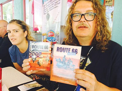 Zdenek Jurasek, president of Czech Route 66 Association, shows two documentary films he's produced about the famous American highway. He's traveling Route 66 this year with his daughter, Adela. (HUBBLE RAY SMITH/Miner)