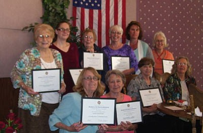 From left to right: standing are Toni Hupp, Christine Lawson, Joan Jordan, Janelle Hudson, Ruth Zimmerman and Angie Sills; first row, Marianne Huffer, Louise Miller, Robin Nicely and Jayne Seieroe.<br> <br> Daughters of the American Revolution: The Lewis Kingman Chapter of the Daughters of the American Revolution recently honored a number of members for their contributions to the chapter during this past year. With grateful thanks for their service, recognition certificates were awarded to: Toni Hupp, acting vice regent and Project Patriot committee chairman; Christine Lawson, Insignia Committee chairman; Joan Jordan, chapter hostess; Janelle Hudson, recording secretary; Ruth Zimmerman, treasurer; Angie Sills, public relations chairman; Marianne Huffer, corresponding secretary; Louise Miller, teller and organizer; Robin Nicely, acting chaplain; Jayne Seiero, Service to Veterans Committee chairman. Not pictured: Kirsten Wilson, chapter regent; Grace Van Horn, chairman: American Flag Committee & American Indian Committee; Lucille Sunde, Lucky Lady chairman; Andi Multer, librarian. Our recognition luncheon took place at Calico's. A special thank you goes to Dottie Paulson for leading our group in singing patriotic songs: America, My Country 'Tis of Thee; and America the Beautiful. DAR gratefully welcomes participation by businesses in our ongoing and upcoming fundraising activities and is happy to support those businesses. Schwan's popular home and online food delivery service will donate part of the purchase proceeds to our chapter's veterans projects. When anyone, anywhere, places a Schwan's order by phone, online or from home, mention/save these DAR numbers when you order - Title: DAR for Military Personnel and Veterans, Campaign ID No.: 20247 and Fundraiser ID No.: 50856. For orders placed from now thru May 29, Schwan's will contribute 40 percent of sales to DAR. Then, for orders placed through April 14, 2016, Schwan's will donate 5 percent of sales to our chapter when our numbers are mentioned. For more information, email kingmanregent@yahoo.com.