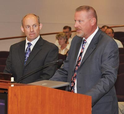 Mohave County Court Administrator Kip Anderson, left, and Presiding Judge Charles Gurtler address the Mohave County Board of Supervisors in this photograph taken in 2012. Gurtler seeks public comment on three finalists to replace Judge Julie Roth, who is retiring in July. (Miner)