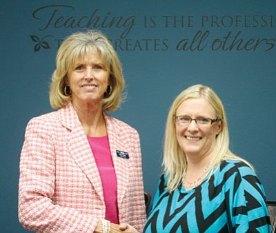 JC AMBERLYN/Miner<BR>From left, Betsy Parker, superintendent of the Western Arizona Vocational Education/Joint Technical Education District, welcomes Amy West, who will step into Parker's position July 1.