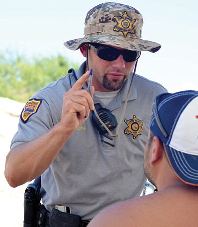 Game and Fish Region 3 wildlife manager Luke Apfel tests a possibly impaired watercraft operator in 2013. Game and Fish and other agencies, including the Mohave County Sheriff's Office, have focused on educational campaigns over the past several years to reduce the number of impaired operators on the county's congested waterways. That effort has begun to pay dividends. (Courtesy)