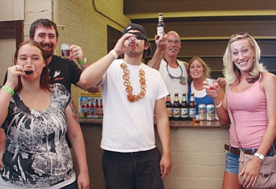 From left to right, Jennifer and JD Cole, Nick Jack, Scott Ellis, Stephanie Clements and Stephanie Bethards enjoy their time at the Beer Fest last year. Ellis and Clements were providing samples from Miller Coors Canyon Distributing. (JC AMBERLYN/Miner)