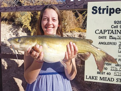 Laura Borden caught this big channel cat last Saturday night while pre-fishing for this weekend's Stripe-R-Rama tournament at Lake Mead. The catfish is largest she has ever caught and weighed 6 pounds, 8 ounces. (DON MARTIN /For the Miner)