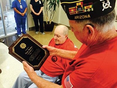 HUBBLE RAY SMITH/Miner<BR> Officer of the Day Gary Wilson presents Stan Yardas with a plaque commemorating his 22 years of dedication and service to VFW Post 3516 in Kingman.