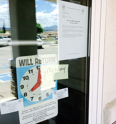 HUBBLE RAY SMITH/Miner<BR> A sign on the door of the Arizona Registrar of Contractors office at 715 Main St. in Kingman notes it will be closing at the end of June. Four registrar offices are going to be closed, cutting three jobs.