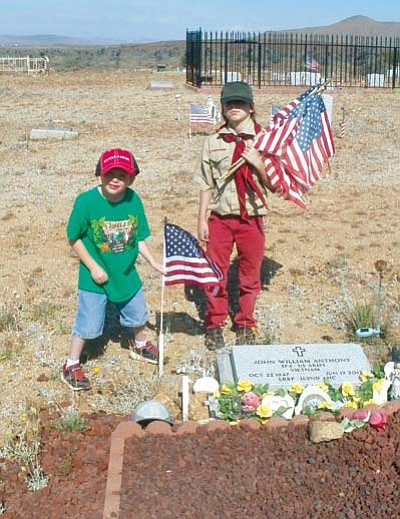 Courtesy<BR>William Shelton and Ronald Hulse place a flag on Ronald's grandfather's grave.