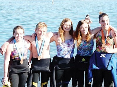 Courtesy<br>The group from Swim Neptune of Kingman after finishing the swim. From left are Callie Wright, Nic Depner, Sophie Depner, Victoria Depner, and Stasi White.