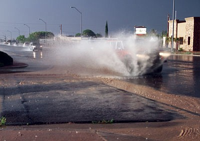 JC AMBERLYN/Miner<BR> A truck sprays some water on Stockton Hill Road during a July 2014 monsoon.
