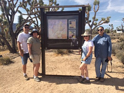 Friends of Joshue Tree Forest: An informational kiosk was installed along Diamond Bar Road. The informational kiosk is located on the south side of Diamond Bar Road, less than a quarter of a mile off of Pearce Ferry Road, and is the result of a partnership between BLM and Friends of Joshua Tree Forest. The kiosk is placed on an advantageous overlook for one of the best views of the Joshua Tree Forest. The kiosk will provide information about the Grapevine Mesa Joshua Tree Forest, including the extensive history of the area, the flora and fauna inhabiting the Joshua Tree Forest and what you can do to help Friends of Joshua Tree Forest preserve the most extensive, densest and healthiest Joshua Tree Forest in the world. The kiosk will include maps of the area along with upcoming events. Friends of Joshua Tree Forest is a volunteer organization dedicated to documenting, preserving and protecting the beauty of the Grapevine Mesa Joshua Tree Forest. If you would like more information, like us on Facebook and check out our website at www.joshuatreeforest.org. Pictured are, from left, Chuck Steffen, Pam Steffen, Sharon Baur and Larry Townsend.