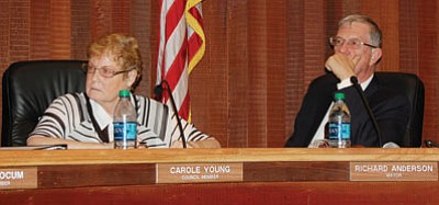 Mayor Richard Anderson and Councilwoman Carole Young did not see eye-to-eye on what transpired between the city and a company that wants to build a steel fabrication plant at the Kingman Airport and Industrial Park at Tuesday's meeting. The next day, however, Young acknowledged she might have misunderstood a conversation the pair had regarding a controversial $1 million check that would ostensibly pay for land on which to build the plant. (DOUG McMURDO/Miner)