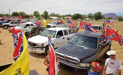 RYAN ABELLA/Miner<BR> Cars lined up at Station 66 on Saturday flying the Confederate, Gadsden, and American flags.