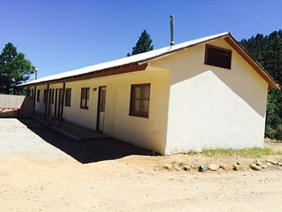 A lodging property at 6570 Flag Mine Road has been purchased by Everett Burge of Hualapai Investments and will be renovated into a four-room motel near Hualapai Mountain Lodge. Zoning was changed from residential to commercial. (HUBBLE RAY SMITH/Miner)