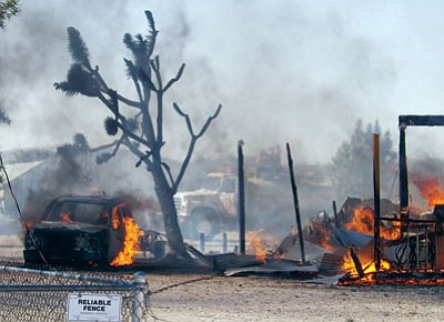 Courtesy<BR> A property in Dolan Springs burns in this photo taken last March. Residents of the small community off U.S. 93 are worried over a lack of adequate fire protection and emergency medical help in the wake of budget-gutting legislation that impacted the state's fire districts.