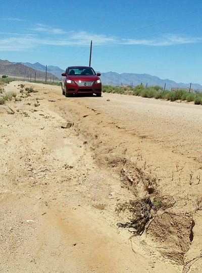 Courtesy<BR> Roads throughout Mohave County took a beating during the last set of storms. Mohave County Public Works' Steve Latoski says the deparment is doing its best to repair the damage.