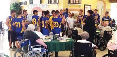 The Kingman High School football team had other activities than football during the Bulldogs' recent camp that ended last week. The team went to the Gardens to spend time with the patients there. KHS begins regular-season practice at 3:30 p.m. Monday. (SHAWN BYRNE/Miner)