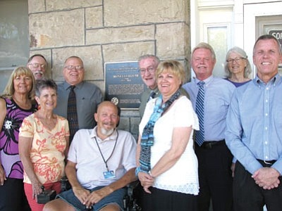 Pictured are, from left: back row, Shannon Rossiter, director of the Mohave Museum; Bill Wales, president of the board; Bill Porter, board member; Bill Ekstrom, board member; and Cathy Kreis, staff; front row, Kathy Smith, board member; Sue Snell, secretary; Bill Shilling, board member; Kathy Ott, vice-president; and Robert Moon, board member. (Courtesy)