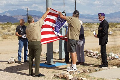 Members of the VFW Post 2555 in Golden Valley raise the American Flag in observance of Purple Heart Day.