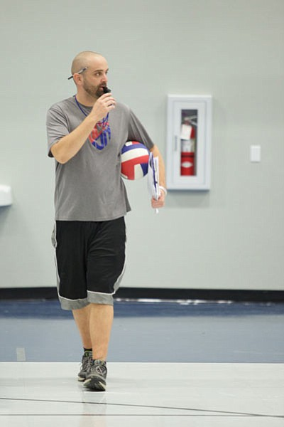 Ken David patrols the practice floor during his first practice as Kingman Academy volleyball coach Monday. David hopes to lead the Lady Tigers to more than three wins for the first time as a member of the AIA. (RYAN ABELLA/Miner)