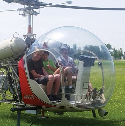 Nic Depner, left, in a Bell 47-G2 helicopter at the Experimental Aircraft Association's Young Eagles camp. (Courtesy)