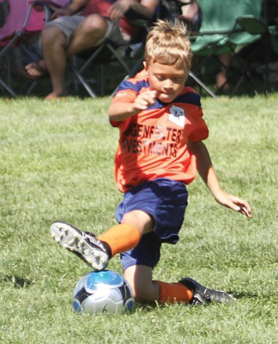 Seth Clausen tries to advance the ball during local soccer action last year. The Kingman Youth Soccer League, which takes over after 29 years of the Northern Arizona Youth Soccer League, has opening ceremonies and season openers beginning at 8 a.m. Saturday at Centennial Park. (JC AMBERLYN/Miner)