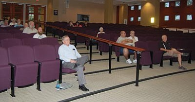Previous meetings on the proposed Kingman Crossing project attracted much larger crowds than the one Tuesday night. (DOUG McMURDO/Miner)