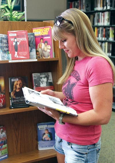 JC AMBERLYN/Miner<BR> Hannah Grasser reads at the Mohave County Library-Kingman on Thursday. She said she often goes to the library to study.