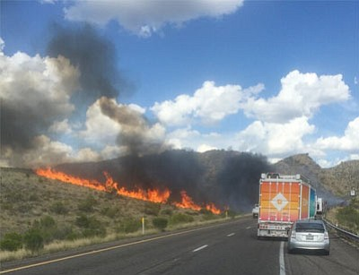 An RV fire sparked a brushfire that burned so hot it damaged a section of pavement on Interstate 40 about 20 miles east of Kingman Monday afternoon. (PAT SCRUGGS/Courtesy)<br /><br /><!-- 1upcrlf2 -->