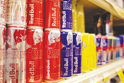A multitude of Red Bull flavors, as well as a dozen other energy drinks, are available to consumers looking to get an extra kick of energy. Each can of Red Bull has less caffeine than a cup of coffee, but also contains a significant amount of sugar content and a blend of taurine and glucuronolactone. Competitors have wildly varying caffeine and sugar contents. (RYAN ABELLA/Miner)