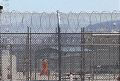 JC AMBERLYN/Miner<BR> A lone inmate walks in the yard at the Arizona State Prison-Kingman in Golden Valley. More than 1,200 inmates have been moved to other facilities following four days of rioting in early July.