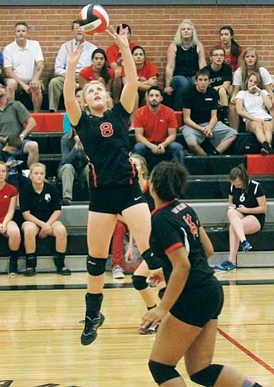 JC AMBERLYN/Miner<BR> Lee Williams' Sadie Snay sets up one of her 22 assists to Chania Scott during the Lady Vols' four-set win over Kingman Academy Thursday at LWHS.