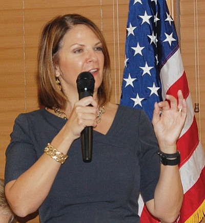Dr. Kelli Ward addressed a crowded and energetic audience at Wednesday's monthly Mohave Republican Forum in the Golden Corral Restaurant. (DOUG McMURDO/Miner)