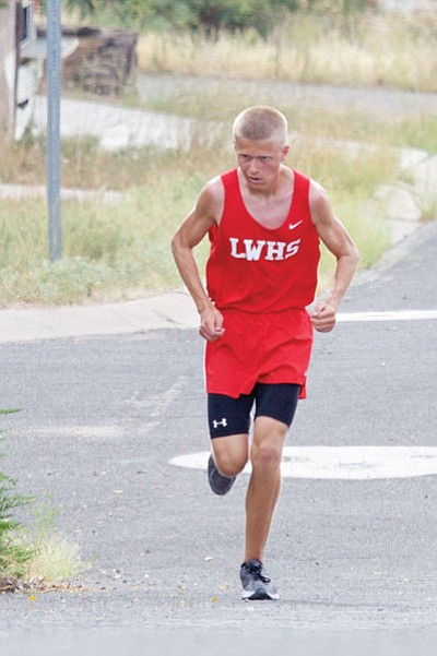 Lee Williams' Brendon Allred fights up the hill on Copper Street in downtown Kingman on his way to Wednesday's win in the LWHS Multi.  (RYAN ABELLA/Miner)