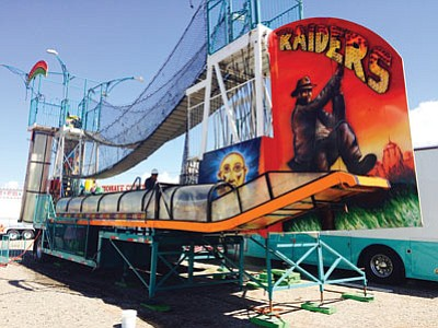 Crews have been setting up carnival rides and food booths all week at the Mohave County Fairgrounds. The popular all-day ride tickets for the carnival are sold out. (HUBBLE RAY SMITH/Miner)
