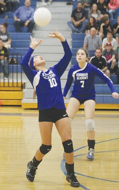 Academy's Shaunti Short plays a set from deep in the back row with Kiersten Kinsey ready to react. Short had 30 assists in the Lady Tigers' win over Kingman Tuesday. (JC AMBERLYN/Miner)