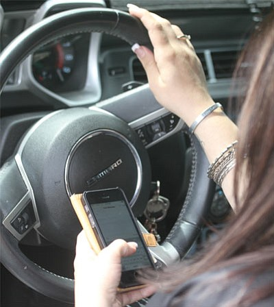 Texting while driving increases the odds of causing a wreck, according to studies and statistics. (JC AMBERLYN/Miner)