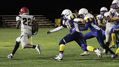 JC AMBERLYN/Miner<BR> Kingman's defense tries to chase down Coronado's Victor Caison-Washington Sept. 11 at KHS. The Bulldogs had a hard time chasing Parker Friday in their 34-6 loss.