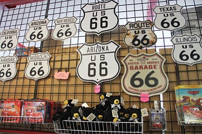 Metal Route 66 signs are popular sellers at the Memory Lane Gift Shop.