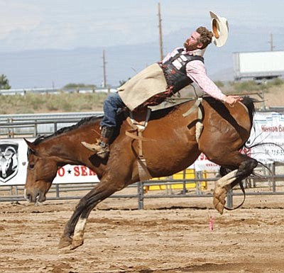 The Andy Devine Days Rodeo will be held this weekend at the Mohave County Fairgrounds. These photos are from 2014. This is Bareback rider John Killian from Chino Valley.