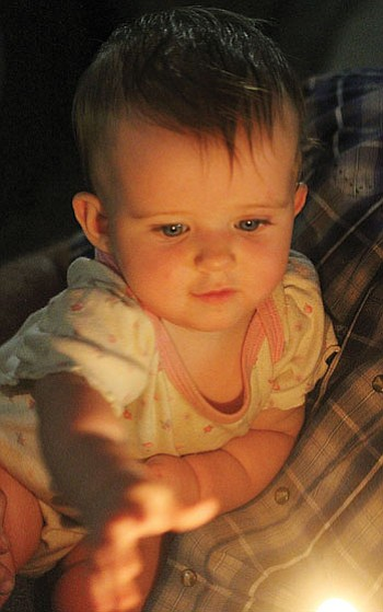 JC AMBERLYN/Miner<BR>Alitza Severns, 8 months old, reaches for a candle during the ceremony (she wasn't allowed to grab it).