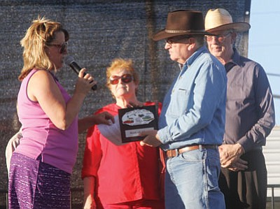 "JC AMBERLYN/Miner<BR> Friday evening saw the kickoff to the Best of the West on Route 66 Festival, held at Locomotive Park and featuring car shows, authors, artists, music, vendors and more. Here, Festival Director Dora Manley presents Jim Hinckley with a plaque naming him ""King of the Mother Road 2015"" as City Councilwoman Carole Young and Mayor Dick Anderson watch."
