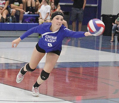 JC AMBERLYN/Miner<BR> Kingman Academy's Breezy Weber tries to keep the ball in play during the Lady Tigers' three-set loss to Lee Williams Thursday at KAHS.