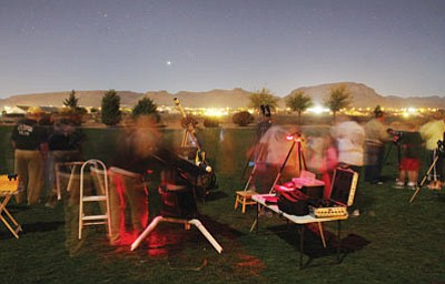 Members of the High Desert Astronomy Club stargazing in 2010. In this thirty-second night exposure, people can be seen as they look through various telescopes that members set up to look at stars, planets and other celestial sights. The Astronomy Club holds several Star Parties a year. Contact Dan at (928) 753-6744 or Leon at (928) 753-9949 for more information.  (JC AMBERLYN/Miner)