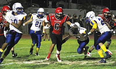 JC AMBERLYN/Miner<BR> Lee Williams' Nate Cottrell runs through a big hole Friday night in action against Kingman High. The Volunteers won the first varsity football game between the two schools Friday, 42-20., as Cottrell rushed for 189 yards and four touchdowns.