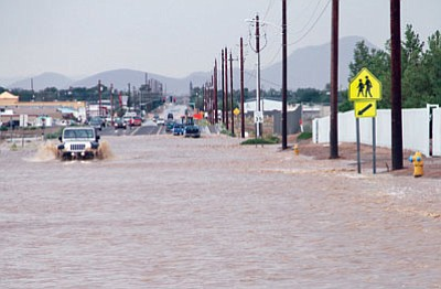JC AMBERLYN/Miner<BR> Flooding on Bank Street in front of Kingman High School during a monsoon storm in July 2013.